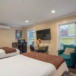 Queen Queen Premium Room  at the Glenmore Plaza Hotel
